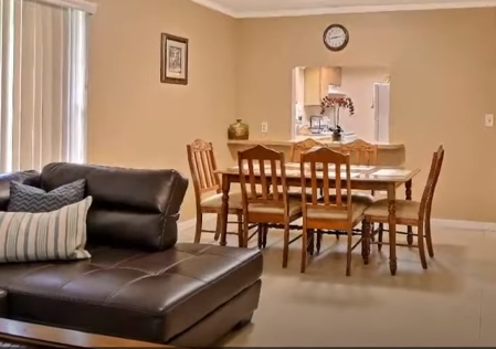 Inside view of unit's couch and dining room table
